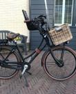 Elektrische Stella fiets met mand en kinderzitje