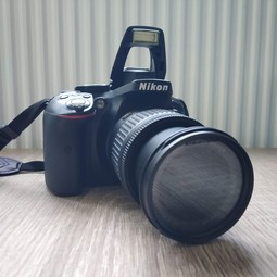 Nikon D5300 DSLR camera + SD card + bag