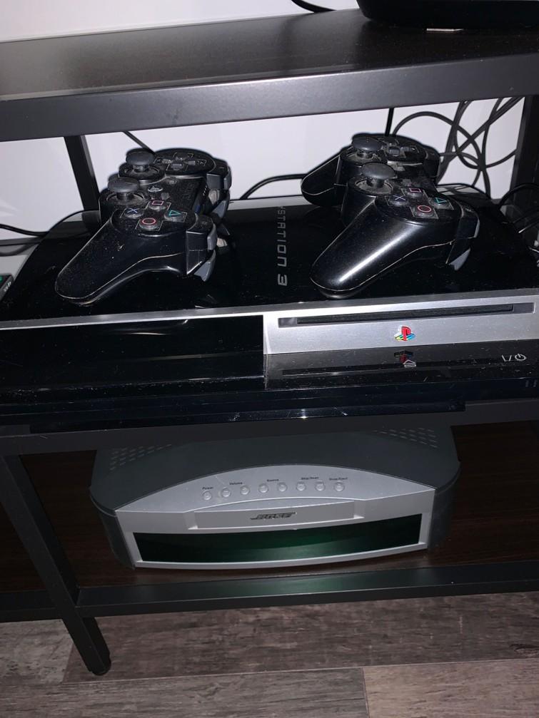 Playstation 3 met 2 controllers